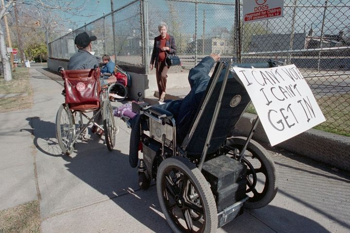 Two major obstacles disabled people face while voting in person are waiting in lines and accessing voting sites. (File photo from Nov. 8, 1988, Denver, Colorado)